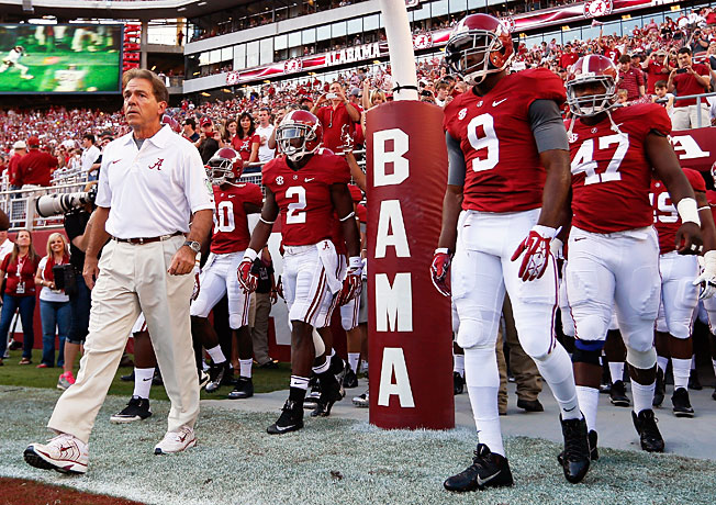 Nick Saban (far left) wants 'Bama to get back to basics after ending 2013 with two straight losses.