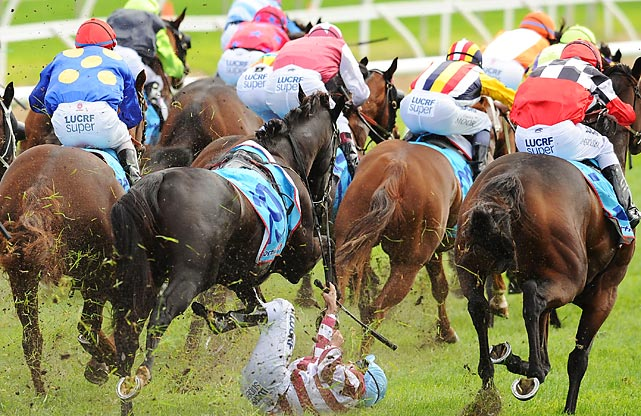 Jockey Vlad Duric endures a scare, falling off Golfing in in the home straight at the Bert Bryant Handicap in Melbourne, Australia.