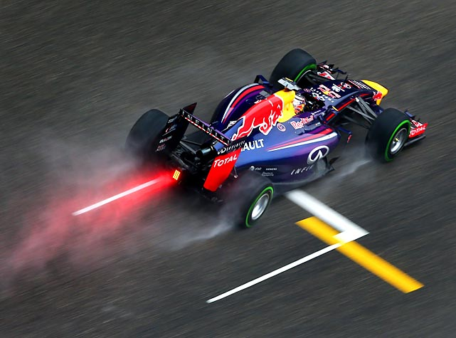 Germany's Sebastian Vettel of Infiniti Red Bull Racing leaves a trail during qualifying for the Chinese Formula One Grand Prix in Shanghai.