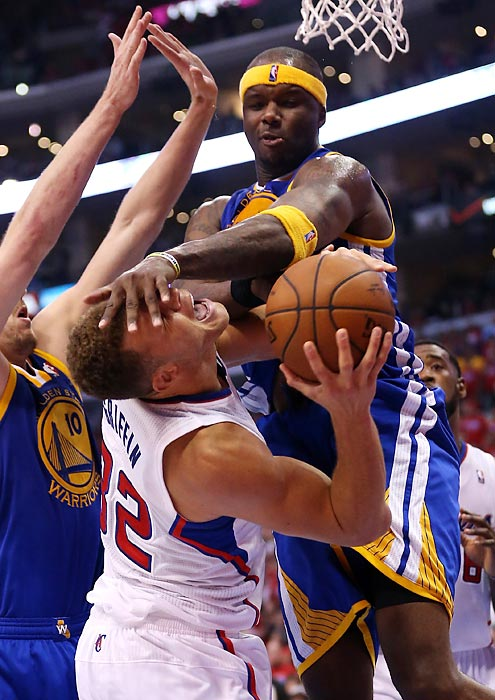 Blake Griffin of the Los Angeles Clippers takes a hard foul from Jermaine O'Neal of the Golden State Warriors in the first game of their Western Conference quarterfinal series.