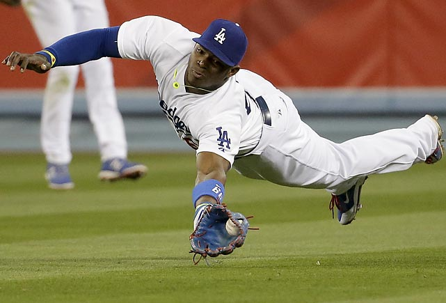 Yasiel Puig of the Los Angeles Dodgers goes airborne to rob Arizona's Paul Goldschmidt of a hit.