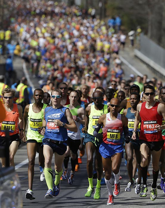 Elite men's runners compete near the start of the 118th Boston Marathon.