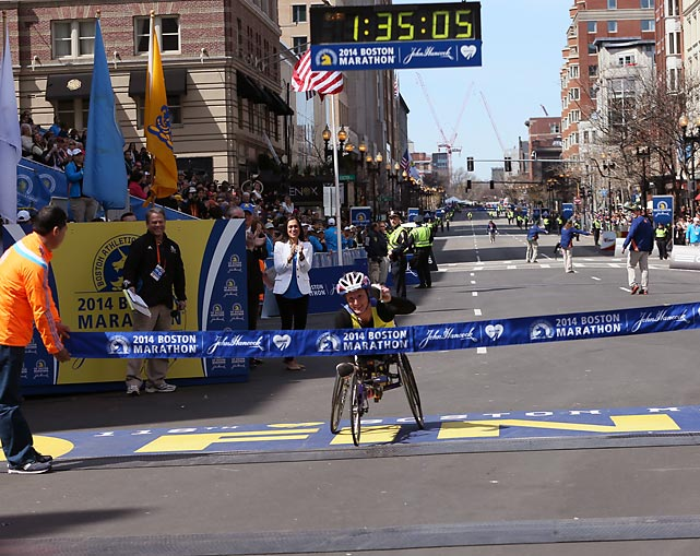 Women's wheelchair winner Tatyana McFadden crosses the finish line.