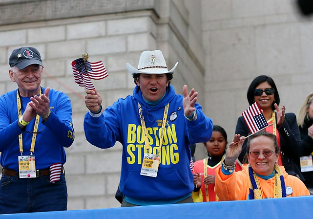 First responder Carlos Arredondo cheers on runners.