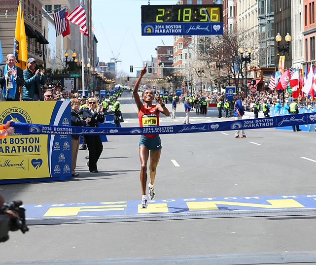 Rita Jeptoo of Kenya wins the women's race with a time of 2:18:57 at the Boston Marathon.