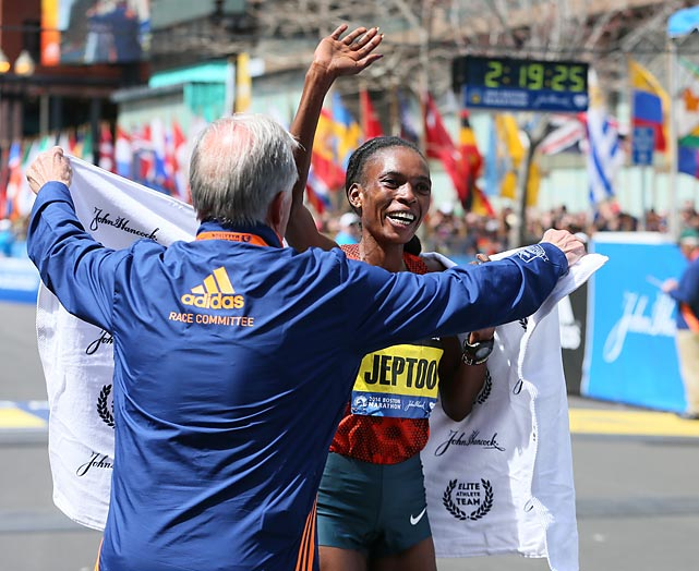 Rita Jeptoo waves to the crowd.