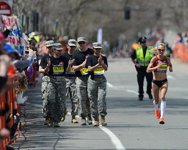 Army veterans cheer on runner Shalane Flanagan.