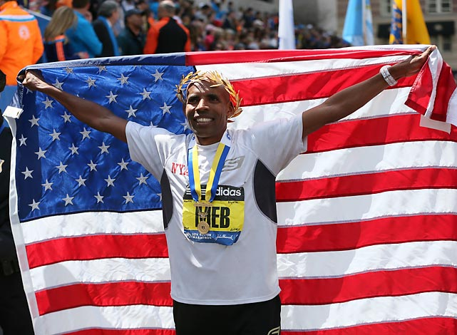 Winner Meb Keflezighi with the American flag.
