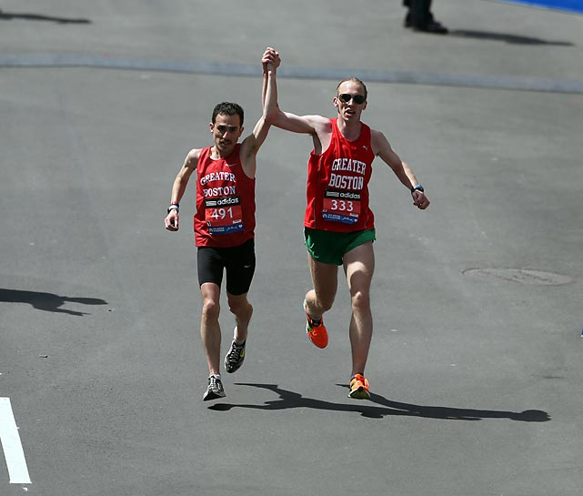 Two runners approach the finish line.