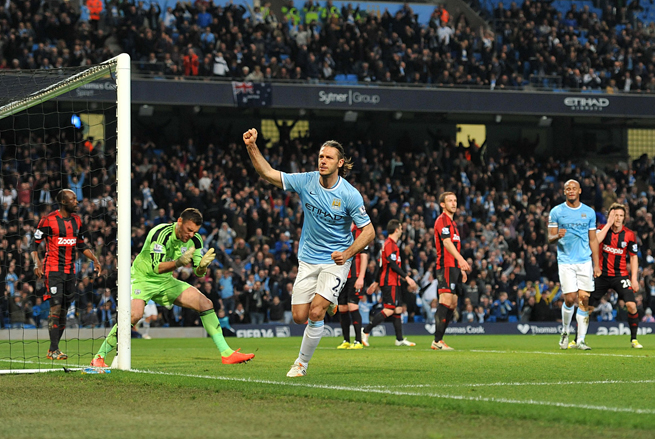 Manchester City's Martin Demichelis celebrates his goal against West Brom on Monday.