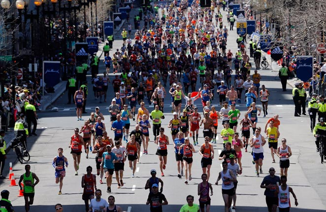 Thousands returned to the site of tragedy at the Boston Marathon finish line on Monday morning.