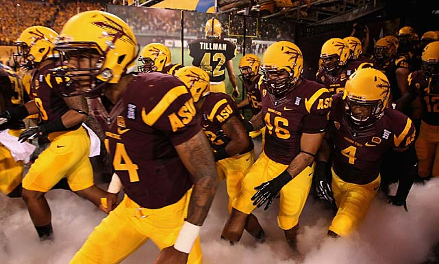 Arizona State Sun Devils run out onto the field past a Pat Tillman photograph before each home game.