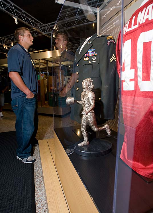 Miami Dolphins rookie first-round draft pick Jake Long looks at the Pat Tillman display at the Pro Football Hall of Fame, in Canton, Ohio, in June 2008. Rookies from all NFL teams toured the Hall of Fame to acquire a better understanding of pro football history.