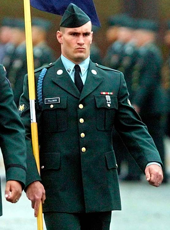 Pat Tillman marches as guidon bearer during graduation ceremonies for his unit in October 2002, at Fort Benning, Ga.