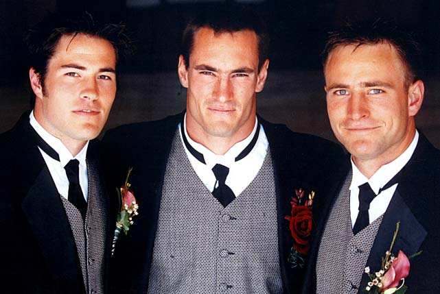 Tillman with his brothers: Richard, left, and Kevin, right, on his wedding day.