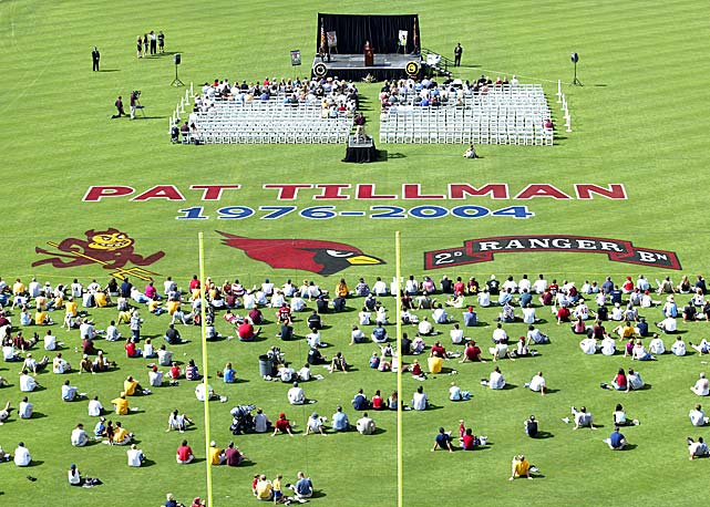 A crowd gathers to remember Tillman at a May 2004 memorial service at Sun Devil Stadium in Tempe, Ariz.