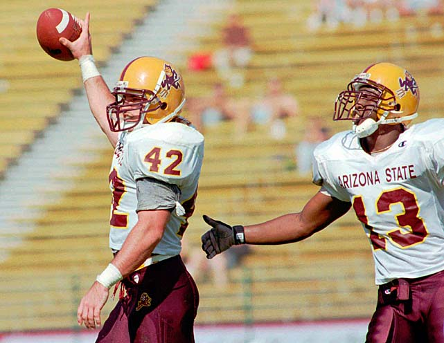 Tillman holds up the ball after intercepting a pass by Stanford quarterback Chad Hutchinson. Tillman was voted the Pac-10 Defensive Player of the Year his senior season.