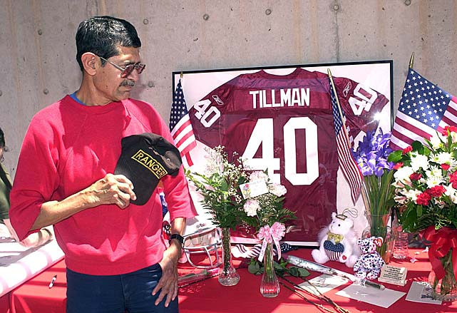 Rudy Lopez,a former U.S. Army Ranger, of Phoenix, pays tribute at a memorial for Tillman.