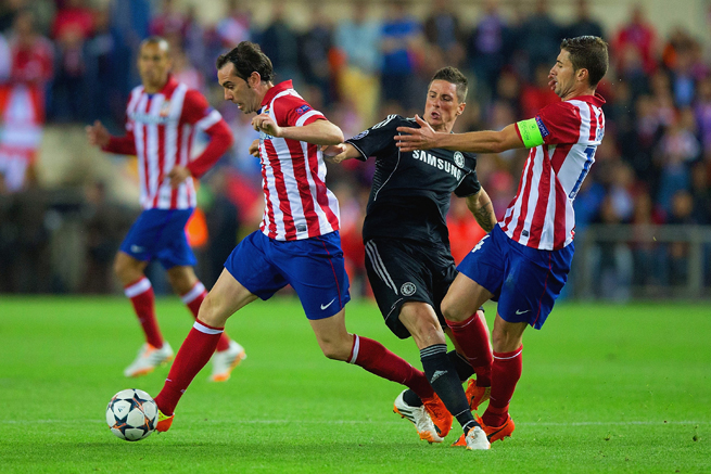 Chelsea's Fernando Torres gets sandwiched by Atletico Madrid's Diego Godin, left, and Gabi in their 0-0 Champions League semifinal first-leg draw.