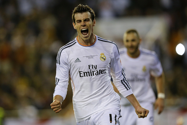 Gareth Bale lets out a celebratory shout after his highlight-reel goal lifts Real Madrid to the Copa del Rey title.