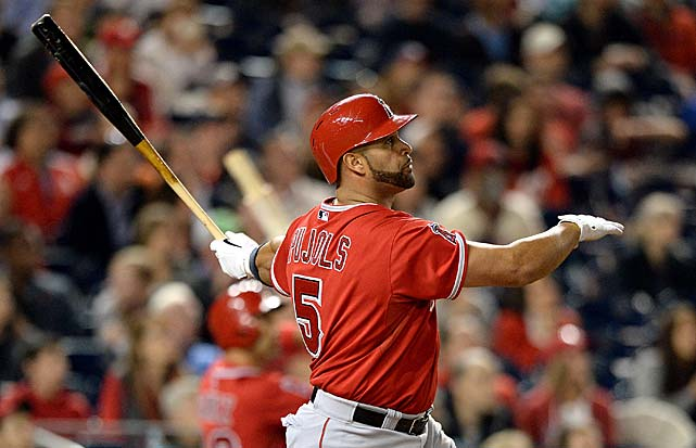 Albert Pujols watches his 500th career home run fly out of the yard on April 22, 2014, which made him the 26th player to reach that milestone and the third youngest ever. Here are some classic photos of the slugger.