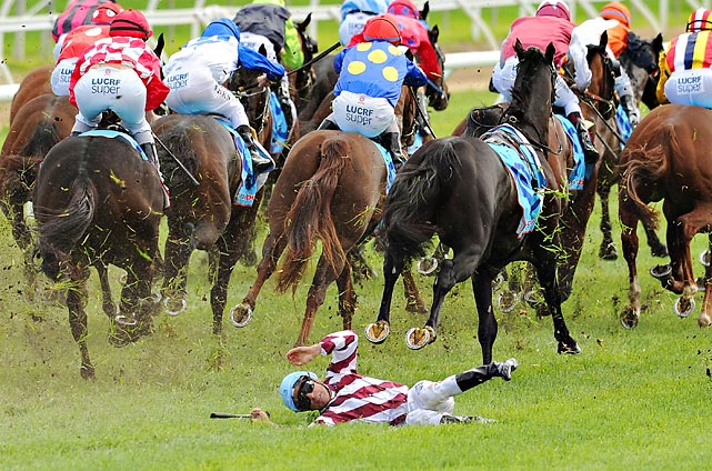 "Jockey Vlad ""The Inhaler"" Duric got a snootful of turf after being shanked off Golfing in the home stretch of the Bert Bryant Handicap at Caulfield Racecourse in Melbourne. Duric hoofed his way off the course with a minor leg injury. Golfing, which went off at 5-to-1, finished at 4:30."
