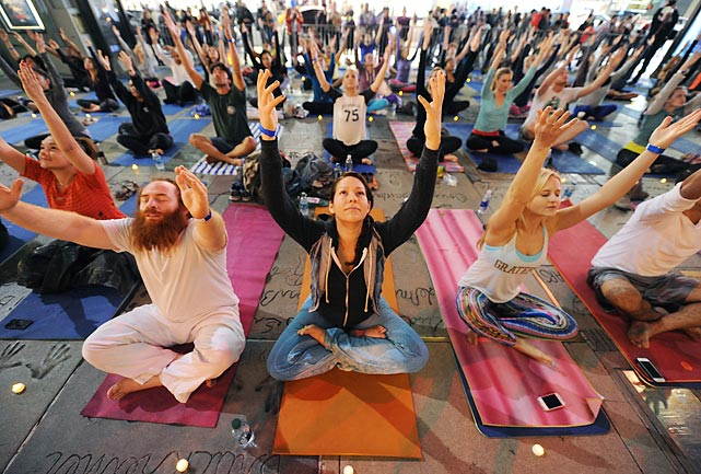 More than 50 yogis (alas, Yogi Berra was not among them, nor was Yogi Bear) struck classic poses from ancient Vedic texts at the Hollywood shrine once known as Grauman's Chinese Theatre.