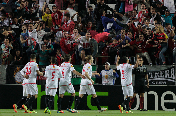 Carlos Bacca, right, leads the celebration after his goal gives Sevilla a 2-0 lead over Valencia in their Europa League semifinal first leg.