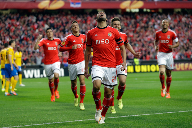 Benfica's Ezequiel Garay, front, celebrates his opening goal in a 2-1 win over Juventus in the first leg of their Europa League semifinal.