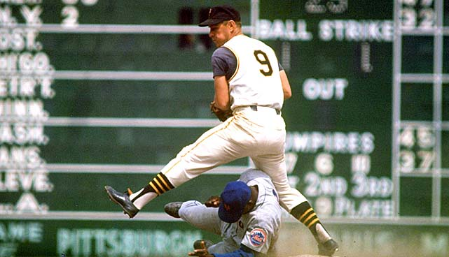 Bill Mazeroski of the Pittsburgh Pirates turns two, avoiding a sliding George Altman of the New York Mets.