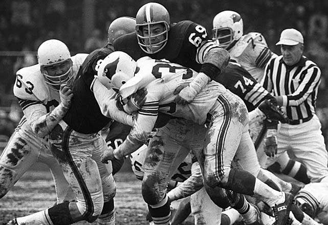 Jim Kanicki (69) of the Cleveland Browns wraps up Joe Childress of the St. Louis Cardinals at Busch Memorial Stadium in St. Louis.