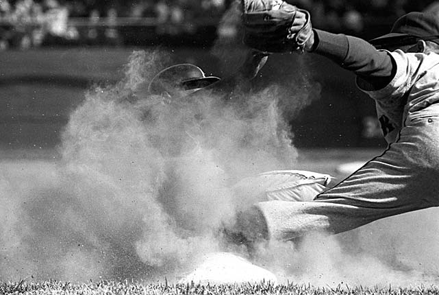 New York Mets third baseman Charley Smith covers the bag at Forbes Field as a Pittsburgh Pirates baserunner is obscured in dust.
