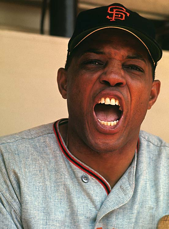 Willie Mays of the San Francisco Giants shouts from the dugout during a game against the New York Mets at Shea Stadium. At age 33, Mays led the National League in home runs with 47.