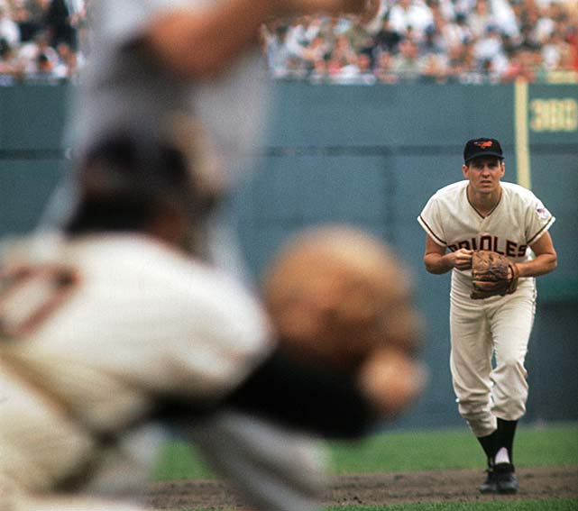 Brooks Robinson of the Baltimore Orioles creeps toward the batter's box against the New York Yankees. Robinson took home MVP honors that season.