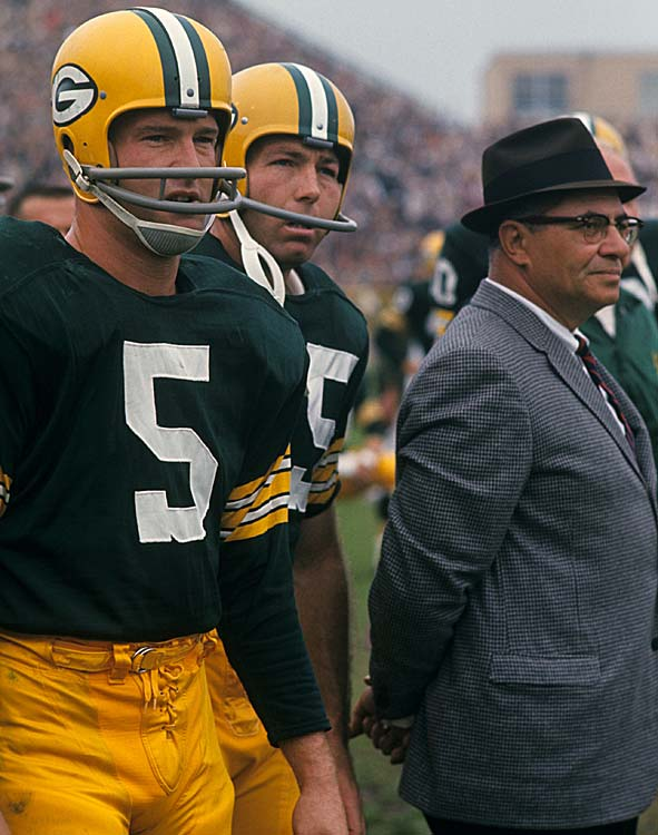 Green Bay Packers Paul Hornung, Bart Starr and head coach Vince Lombardi look on from the sidelines in a game against the Baltimore Colts. The Packers finished second in the NFL's Western Conference.