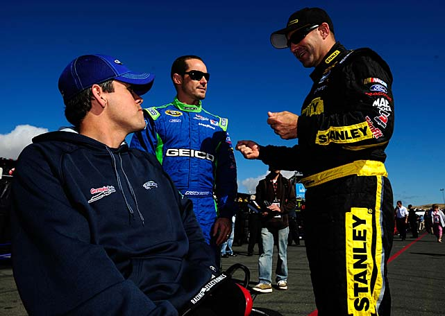 "Casey Mears, center, and Marcos Ambrose, right (pictured here during happier times), got into an altercation April 25 in Richmond, during which Ambrose punched Mears in the eye. ""He got me pretty good with that shot,"" Mears told NASCAR.com the next day, sporting sunglasses to hide the badly bruised and swollen eye. Replays of the incident show Mears and Ambrose talking just after the race ended. The situation escalated when Mears forcefully shoved Ambrose. The driver of the No. 9 Ford then returned with a right hook to Mears' face. Here are some more of NASCAR'S memorable dustups and feuds."