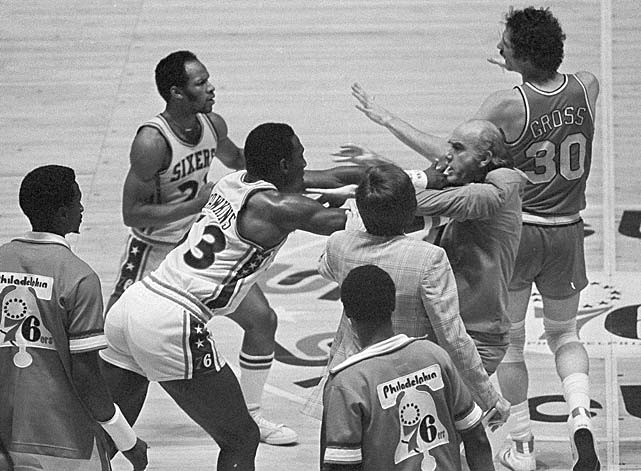 Philadelphia 76ers' Darrell Dawkins shoves coach Jack Ramsay after the Portland coach tried to break up a fight on the floor between Dawkins and several other Blazers during a May 1977 playoff game in Philadelphia. Dawkins was ejected from the game.