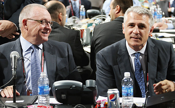 There were no hard feelings as Jim Rutherford (left) handed the Hurricanes' GM reins to Ron Francis.