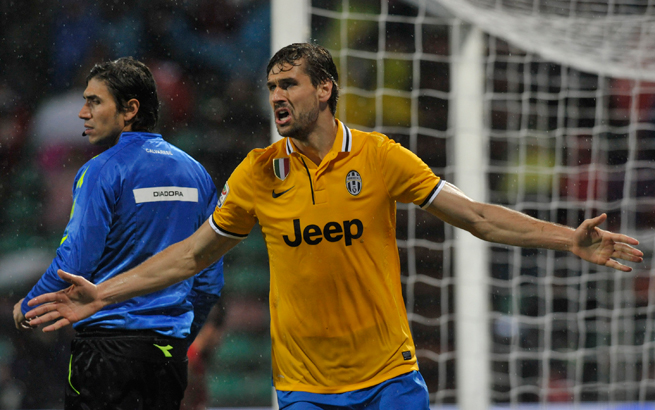 Fernando Llorente celebrates after his back-heel goal during Juventus' 3-1 win over Sassuolo on Monday.
