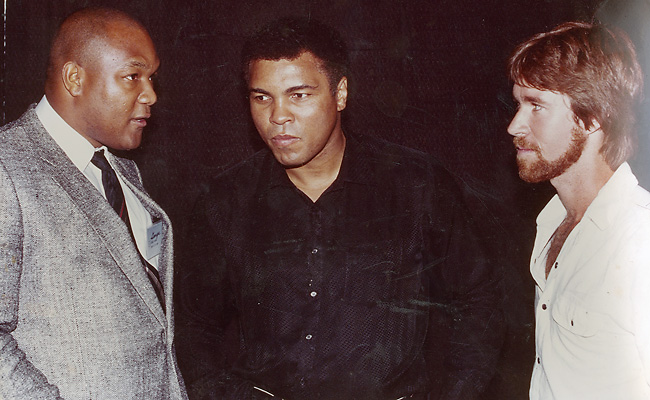 "Gary Smith (right) interviews George Foreman and Muhammad Ali for his 1984 SI story ""After the Fall""."