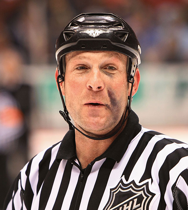 Even the on-ice officials get caught in the fray and have something to show for it.