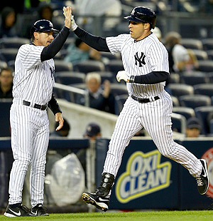 Mark Teixeira gets a high-five after hitting a solo home run vs. the Mariners.