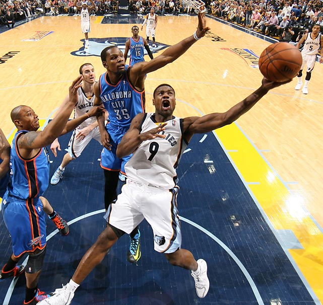 Tony Allen of the Memphis Grizzlies shoots around Kevin Durant of the Oklahoma City Thunder in Game 3 of a Western Conference quarterfinals.