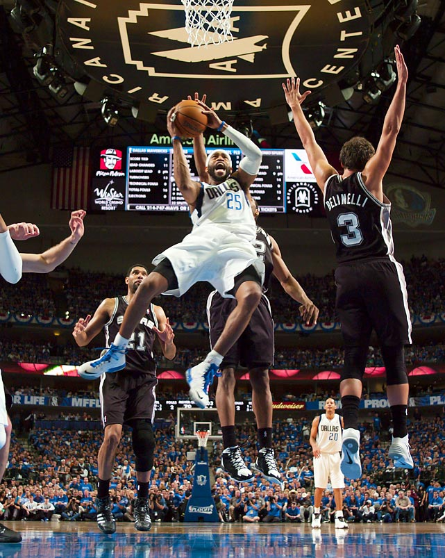 Dallas Mavericks guard Vince Carter soars for a layup against the San Antonio Spurs during Game 3 of a Western Conference quarterfinals.
