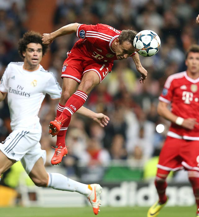 Rafinha of FC Bayern Munich leaps to head the ball against Real Madrid during the first leg of their Champions League semifinal.