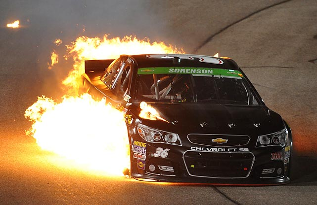 Reed Sorenson's Chevrolet catches fire during the NASCAR Sprint Cup Series Toyota Owners 400 in Richmond, Va.