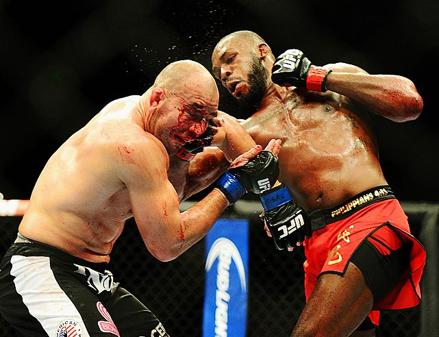 Defending light heavyweight champ Jon Jones strikes a battered Glover Teixeira during UFC 172 in Baltimore. Jones went on to a unanimous-decision victory.
