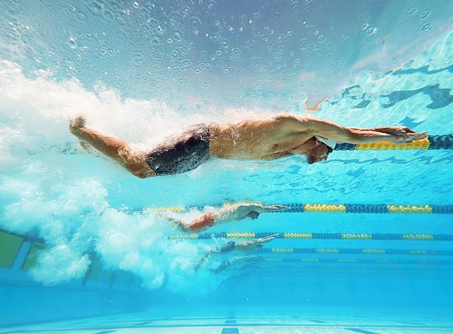 Michael Phelps, newly returned to swimming, competes in the 50-meter Freestyle Preliminary race in Mesa, Ariz.
