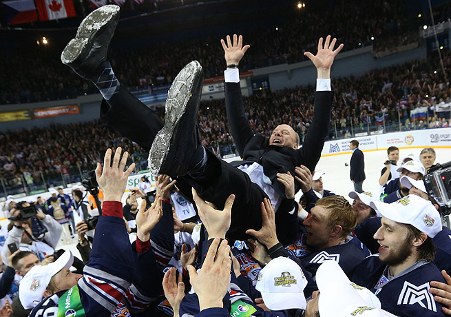Mike Keenan was tossed up in the air by his players after winning the Gagarin Cup with Metallurg.