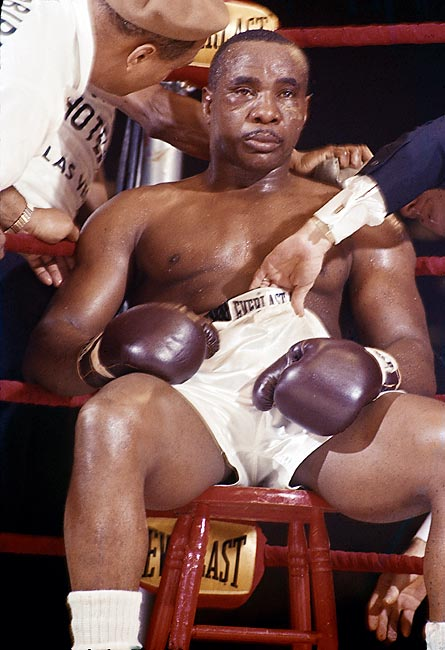 A battered Sonny Liston sits on his stool, unable to begin the seventh round and conceding his heavyweight belt to Cassius Clay.